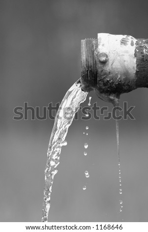 Water Flowing from Pipe - Black and White - stock photo