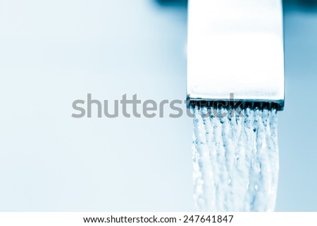 Water Flowing From The Tap - stock photo