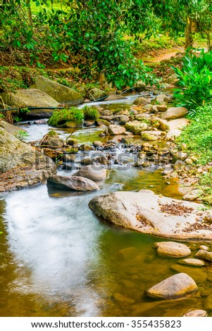 Water Flowing in Natural Park, Thailand. - stock photo