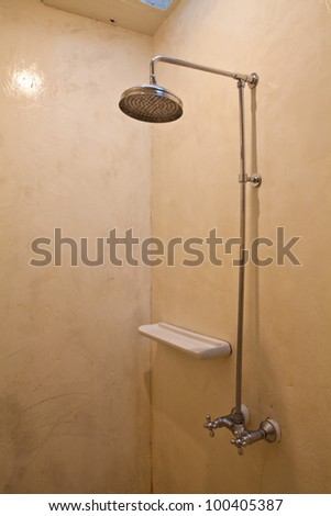 Water flowing in old metal - stock photo