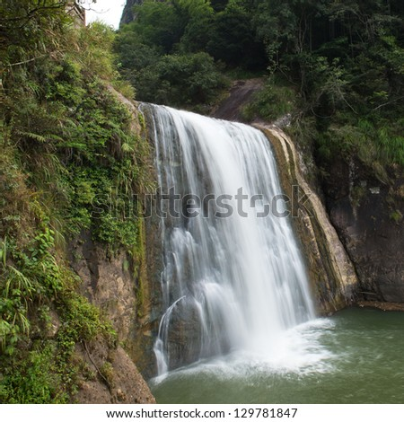 water flowing over falls, long time exposure - stock photo