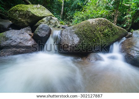 water flowing over the rocks - stock photo