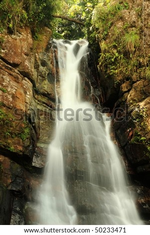 Water flows down La Mina Falls in the El Yunque rain forest in the Caribbean National Forest, Puerto Rico - stock photo