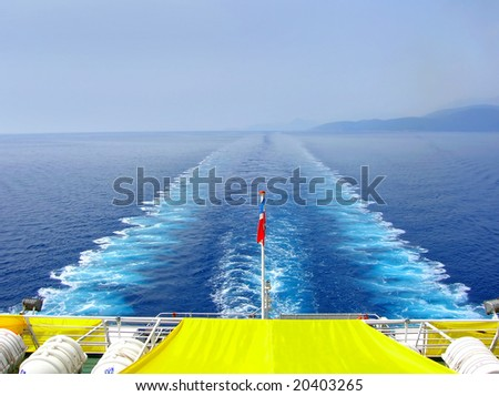 water foam trace behind large passenger ship on adriatic sea - stock photo