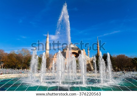 Water fountain. Former Orthodox church Hagia Sofia in the background. - stock photo