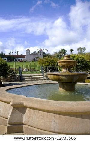 Water Fountain with the Santa Barbara Mission in the background - stock photo