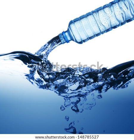 water from water bottle with bubble forming - stock photo