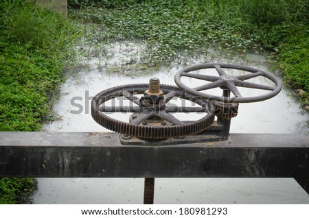 water gate gear  urban wastewater treatment plant. - stock photo
