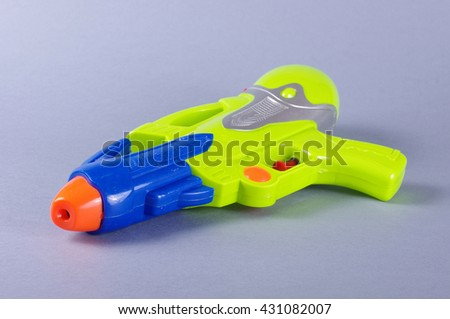 Water gun toy isolated on the gray background - stock photo