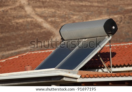 Water heating solar panels on the roof - stock photo