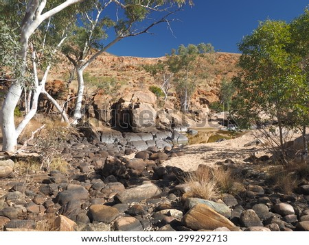 Water hole along the rim walk in the dry Ormiston Pound, Northern Territory, Australia, July 2015     - stock photo