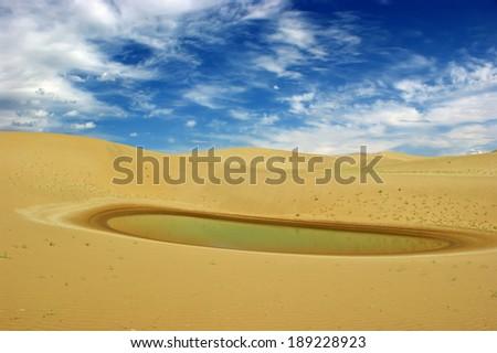 Water in an arid desert. - stock photo