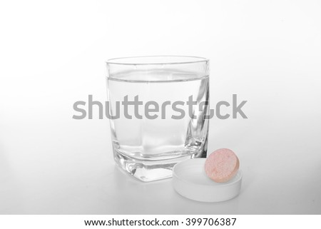 Water in glass and Effervescent Tablets  - stock photo