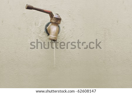 water leaked out from the old tap - stock photo