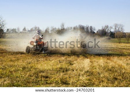 Water match of two quad riders in autumn - stock photo