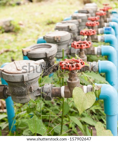 Water Meter and Red Valve - stock photo