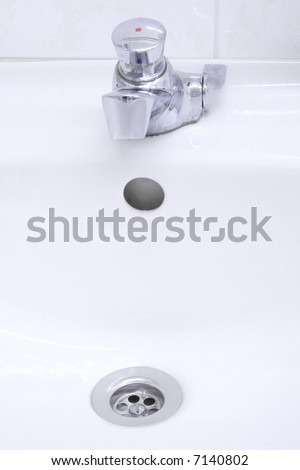 water out of stainless spigot and drain - stock photo
