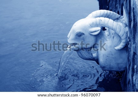 water outlet of the sheep head modelling in a park in China - stock photo