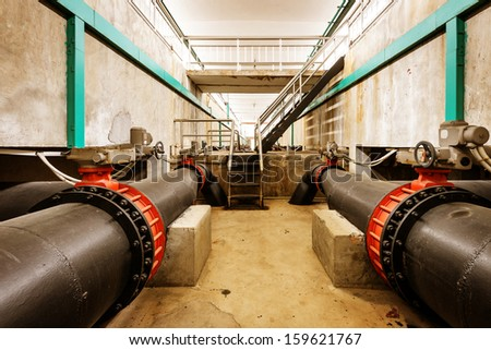 Water pipe in a sewage treatment plant - stock photo