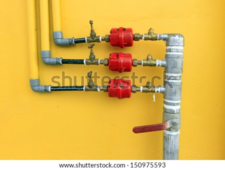 Water pipes and meter - stock photo