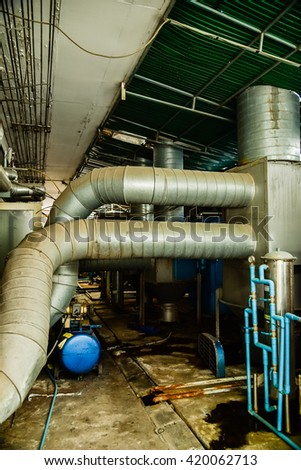 Water pipes under the building - stock photo