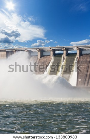 Water plums on hydroelectric power station - stock photo