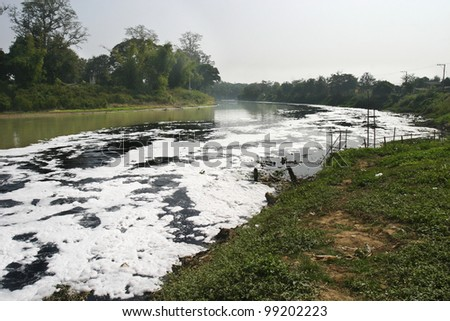 Water pollution in river because industrial not treat water before drain - stock photo
