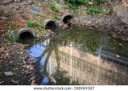 Water pollution in river with trash in bangkok city - stock photo