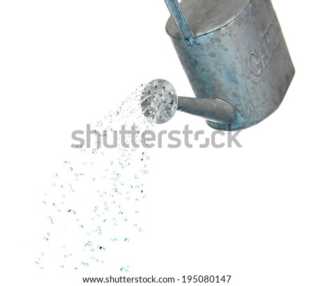 Water pouring from watering can isolated on white - stock photo