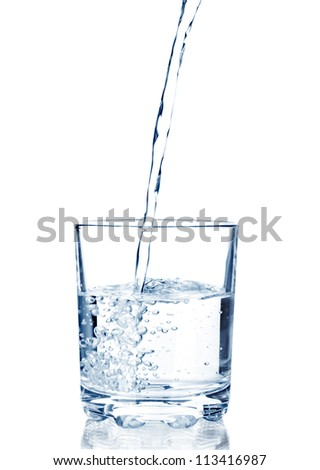 water pouring in glass isolated on white background - stock photo