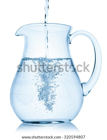 Water pouring into a pitcher, isolated on the white background, clipping path included. - stock photo