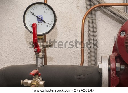 Water pressure transducer and pipe - stock photo