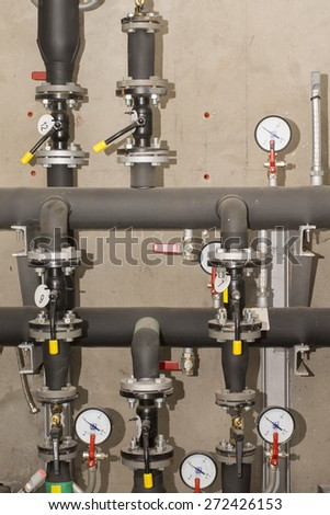 Water pressure transducers and pipe - stock photo