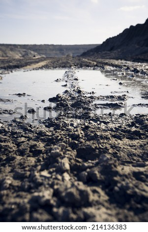 water puddle in a coal mine - stock photo
