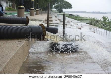 water pump at a khong river - stock photo
