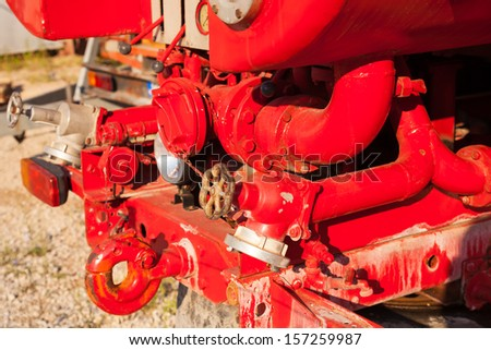 Water pump equipment of old fire truck - stock photo