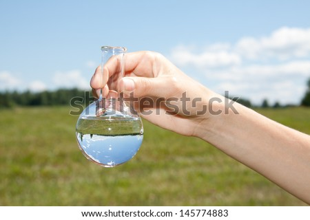 Water Purity Test, liquid in laboratory glassware - stock photo