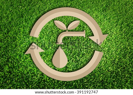 Water recycling. Save water concept. Paper cut of eco on green grass. - stock photo