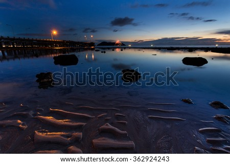 Water reflection and the last light after sunset on Thavorn beach in Phuket Thailand - stock photo