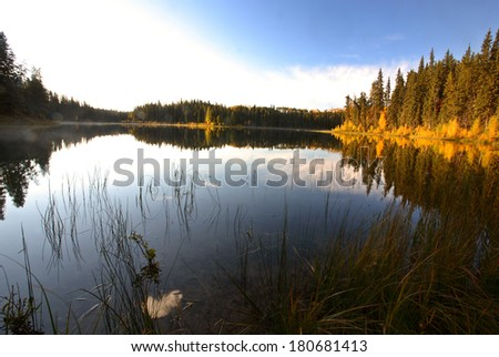 Water reflection at Jade Lake in Northern Saskatchewan - stock photo