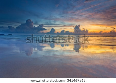 Water reflection during a colorful sunset on Karon beach in Phuket - stock photo