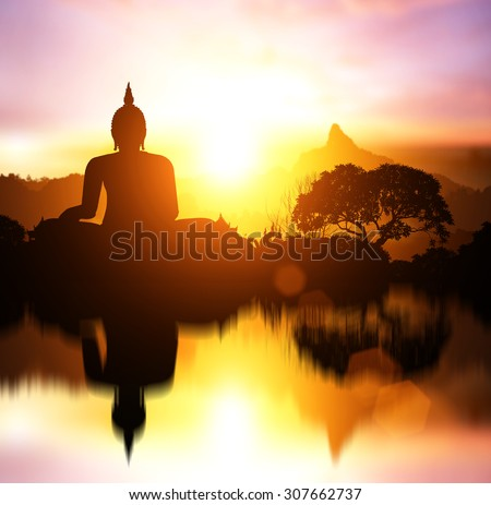 Water Reflection Silhouette of Buddha on  sunset with mountain behind - stock photo
