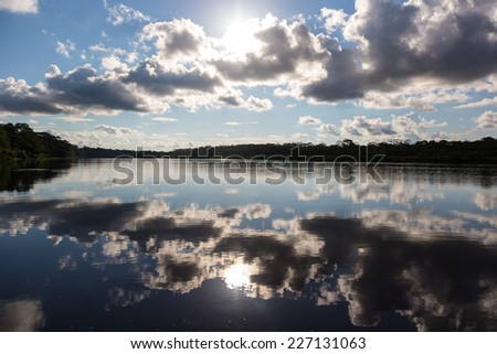 Water reflections over Pucate river in the Amazon jungle, Pacaya Samiria, Loreto, Peru - stock photo