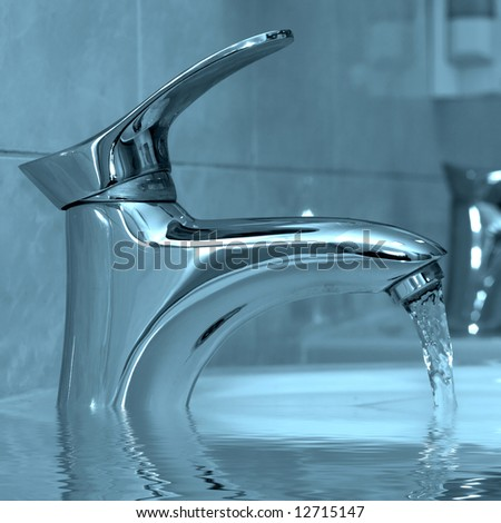 Water running from a modern water faucet - stock photo