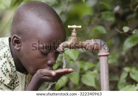 Water scarcity in the world symbol. African boy begging for water. In places like sub-Saharan Africa, time lost to gather water and suffering from water-borne diseases is limiting people's lives. - stock photo