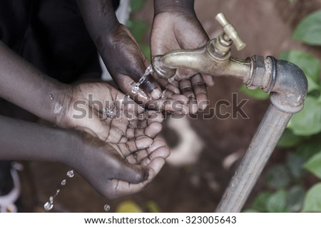 Water scarcity is still affecting one sixth of Earth's population. African Children in developing countries suffer most from this problem, that causes malnutrition and health issues. - stock photo