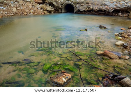 Water sewer pipe with running flow - stock photo