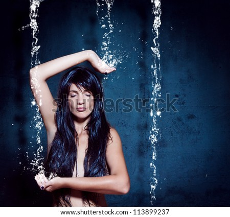 water-spa 02/girl meditating under waterfall - stock photo