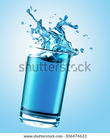 Water splash from glass - stock photo