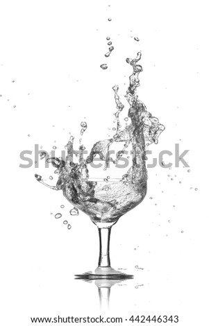 water splash from glass on a white background. - stock photo